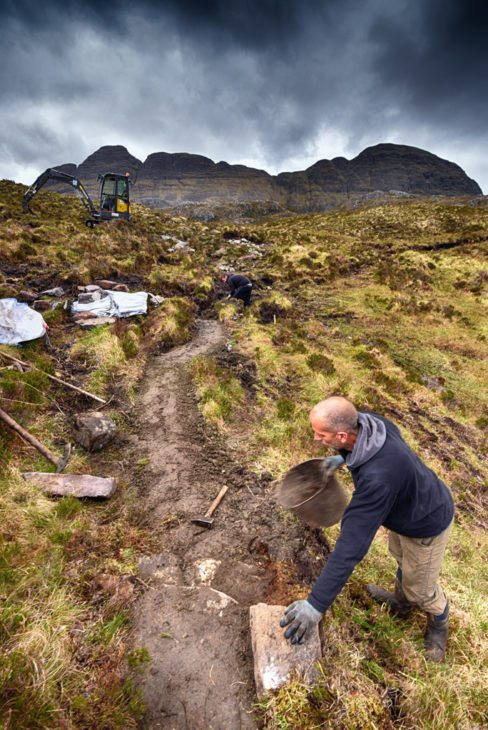 Mark finishing off the drop dressing on the path. Photo © Chris Puddephatt