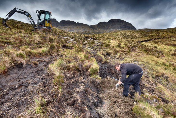Andy shovelling gravel. Photo © Chris Puddephatt