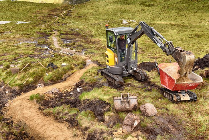 Andy in the digger and the path snaking back. Photo © Chris Puddephatt