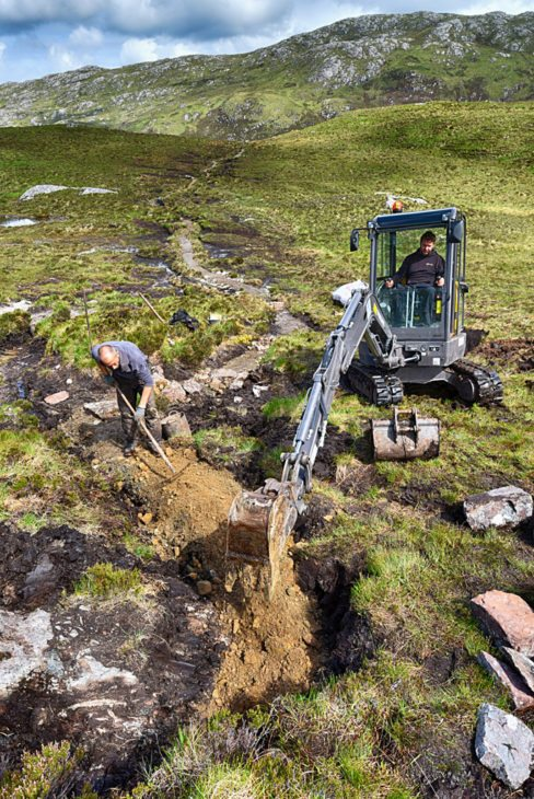 Precision work with the digger. Photo © Chris Puddephatt