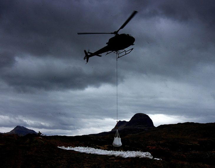 A bag of gravel being airlifted during a lull. Photo © Chris Goodman.