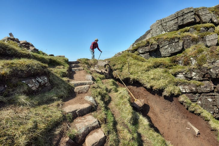 Johny winching stone down the gully on the ridge of Suilven. Photo © Chris Puddephatt