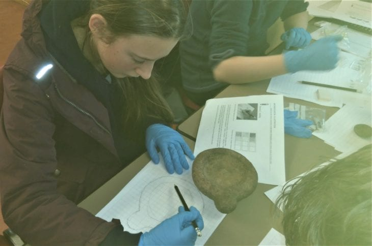 Preparing archaeological sketches of excavation finds © Roz Summers